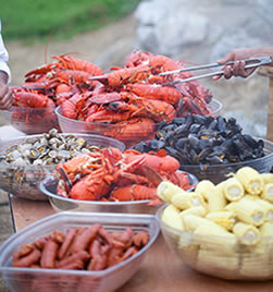buffet table set with lobster clambake