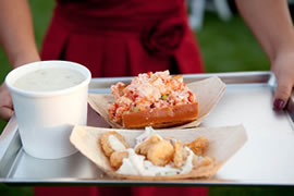 catered wedding reception - tray holding lobster roll, fish tacos and clam chowder